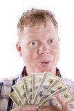 Man with a big fan of money Stock Photos