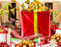 Man with a big gift Stock Image
