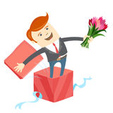 Man in big gift box with bunch of flowers Stock Images