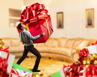 Man with a big gift Royalty Free Stock Photography