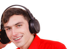 Man in big headphones listening music Royalty Free Stock Image