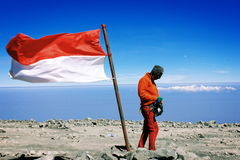 Man With Big Indonesia Flag on the top of Semeru Mountain. The Collection of The Beauty Around Java and Bali Island. Holiday Vibes Royalty Free Stock Photos