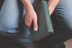 Man with big old book Stock Images