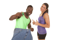 Man big pants woman weight loss Royalty Free Stock Images