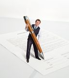 Man with a big pen Stock Photos