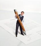 Man with a big pen Stock Photos