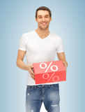 Man with big percent box. Picture of handsome man with big percent box Royalty Free Stock Photography