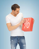 Man with big percent box. Picture of handsome man with big percent box Royalty Free Stock Image