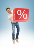 Man with big percent box. Picture of handsome man with big percent box Royalty Free Stock Images
