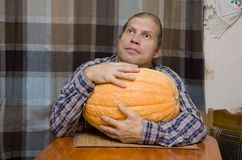 Man with big pumpkin Stock Photography