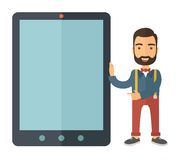 Man with big screen tablet. A Caucasian with beard standing while holding besides a big screen tablet. A Contemporary style. Vector flat design illustration with Royalty Free Stock Photo