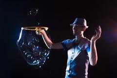 Man with  big soap  bubbles Stock Photos