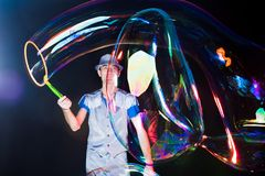 Man with  big soap  bubbles Stock Images