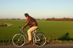 Man on bike. Looking at  green landscape Stock Images