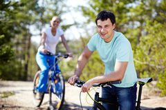Man with a bike royalty free stock image