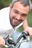 Man on a bike Royalty Free Stock Photography