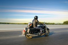 Man on bike. Going on country road Royalty Free Stock Photography