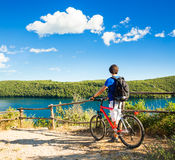 Man with a Bike on Beautiful Nature Background royalty free stock photography
