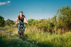 Man On Bike Bicycle Cycling  In Green Summer Sunny Park Royalty Free Stock Images