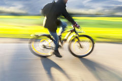Man on bike in blurred motion Stock Photos