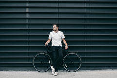 Man with bike in city Royalty Free Stock Image