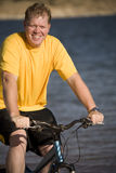 Man on bike close up Royalty Free Stock Photo