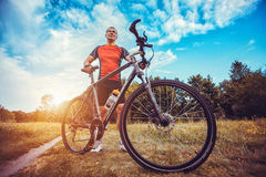 Man with bike enjoy summer vacation Royalty Free Stock Photos