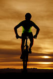 Man on bike facing silhouette Royalty Free Stock Photos