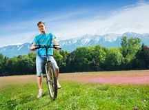 Man on the bike on the field Royalty Free Stock Photography