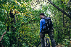 Man with bike in forest Stock Photos