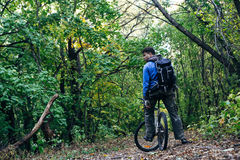 Man with bike in forest Royalty Free Stock Image