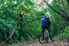 Man with bike in forest Royalty Free Stock Images