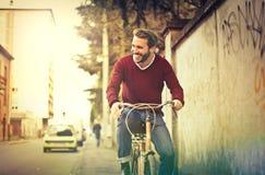 Man with bike Stock Photos