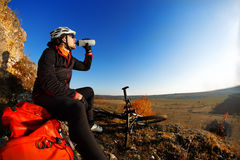 Man in a bike helmet drinks water from bottle. Royalty Free Stock Image