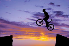 Man on bike jumping silhouette Royalty Free Stock Photo