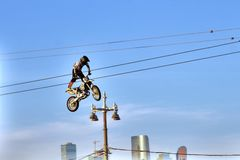 A man on bike jumps over the city. A man on bike jumps. A bikers festival in Moscow, on Vorovyovy Hills. Bikers close the season of 2018. Free entrance public stock photography
