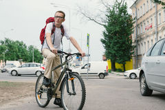 Man at bike on modern street Stock Image
