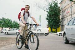 Man at bike on modern street Stock Image