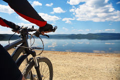 Man with bike on a mountain lake Royalty Free Stock Photo