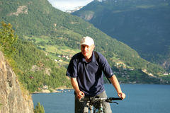 Man on bike in the mountains. Man riding on bicycle in the mountains royalty free stock images