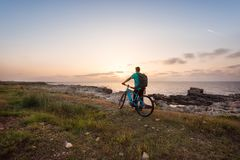 Man with a bike in the nature stock images