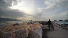 Man on Bike near the Sea on Dock. Video stock video footage