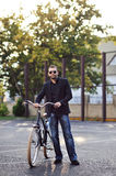 Man with bike Royalty Free Stock Images
