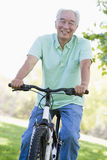 Man on bike outdoors smiling Royalty Free Stock Photo