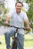 Man on bike outdoors smiling Stock Photos