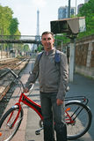 Man with bike in Paris. A Middle Eastern man with a bike on one of the Paris train stations Royalty Free Stock Photos