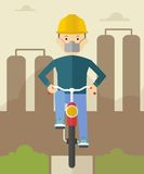 Man on bike in polluted city Stock Photography