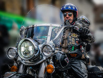The man and his Harley Davidson. Portrait of a man driving his Harley Davidson royalty free stock image