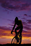A man on a bike riding forward silhouette in the sunset Stock Photo