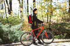 Man with the bike and sunny autumn day Royalty Free Stock Image